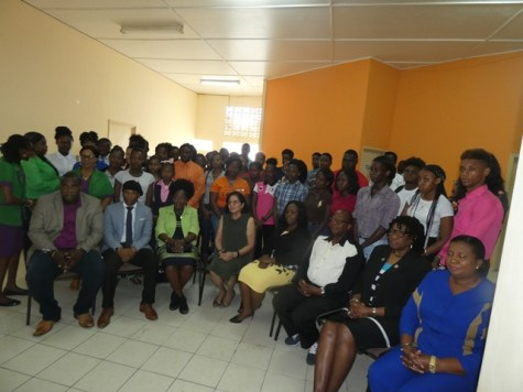 Standing are THE 40 participants who have enrolled in the ICT training. Sitting in front from left: Coordinator Deron Adams, MP Jermaine Figueira, Minister Valerie Patterson-Yearwood, First Lady Sandra Granger, Mayor of Linden Waneka Arrindell, Chief Facilitator Fitzroy Younge, Luitenant Colonel Yvonne Smith and Region Ten Deputy REO Maylene Stephens.