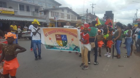 Students participating at the Children's Mashramani parade in Region Six.