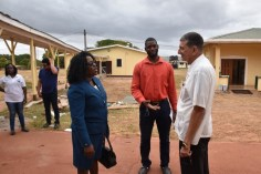 Minister Cummings and Regional Health Officer Dr. Naail Uthman (centre) speaks to Cuban Doctor at the hospital today.