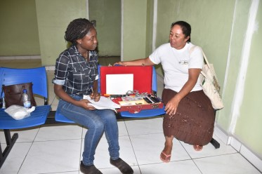 A resident meets with an Optometrist from the Ministry of Public Health