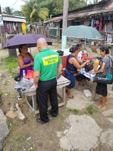 Minister Norton engaging residents along the streets of Bartica, Region Seven