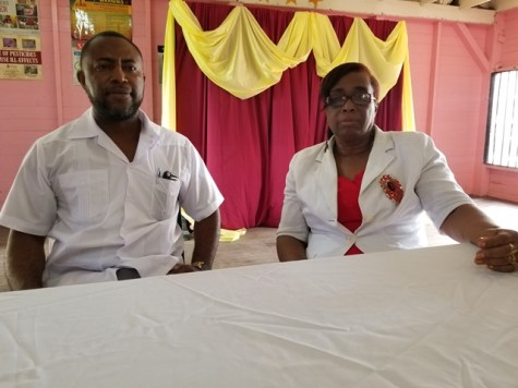 Deputy-Mayor of New Amsterdam, Dwayne McIntosh and Monitoring Officer at Ministry of Education, Eleatrice Davenport.