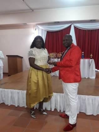 Deputy Commissioner, Maxine Graham giving an award to Commander Edmond Cooper.