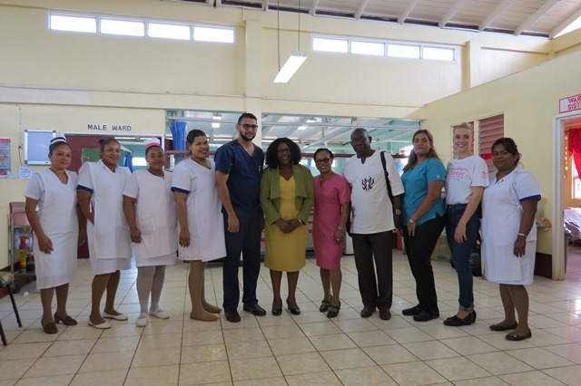 Dr Karen Cummings, Minister within the Ministry of Public Health and Dr Vishal Ramjas, Regional Health Officer (ag) with staff of the Mabaruma Regional Hospital.