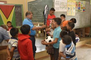 The youths receiving sport gear
