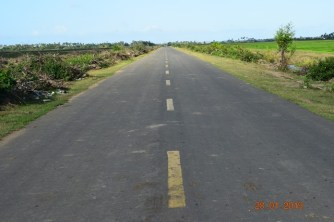 The surface which will be constructed on the extension as seen in another already-completed stretch of the roadway.