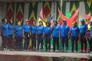 Members of the Ministry of Education performing a national song
