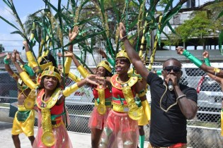 Soca artiste, Jumo Primo performing along with the revellers at the Ministry of Agriculture's band launch.