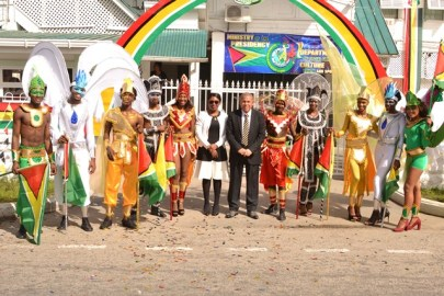 Minister of Culture, Youth and Sports, Dr. George Norton and Permanent Secretary, Melissa Tucker along with some of the models displaying the costumes for the ministry's Mashramani band.