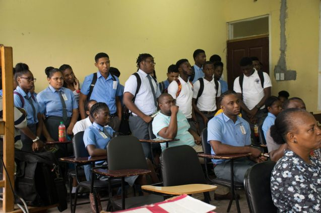 Students listening to the school officials