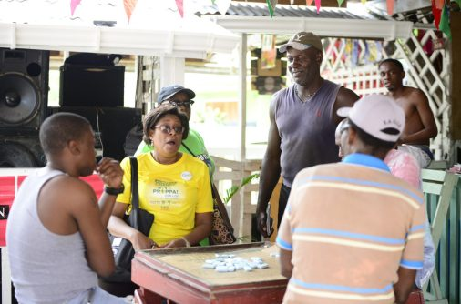 Minister Hughes interacting with Linden residents