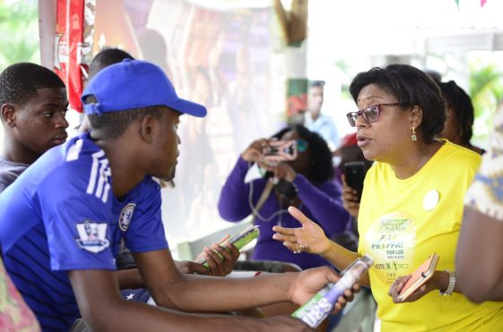 Minister of Public Telecommunications, Catherine Hughes interacting with Linden youth