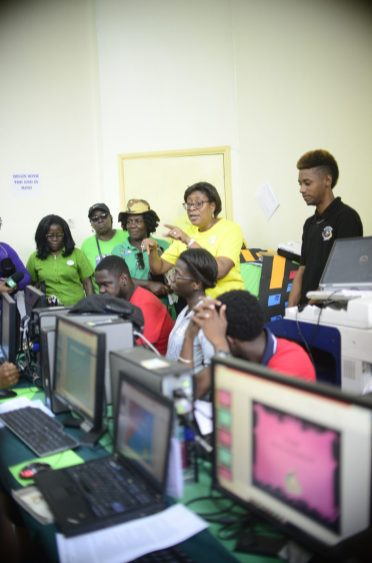 Minister of Public Telecommunications, Catherine Hughes speaks with trainees in the ongoing ICT workshop