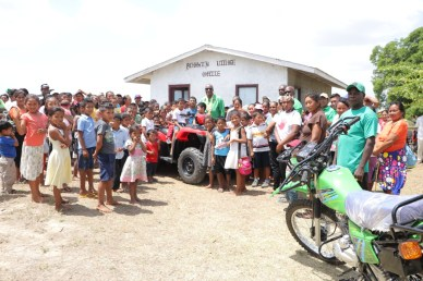 Minister of State, Joseph Harmon and residents of Achiwib at the hand over the ATV