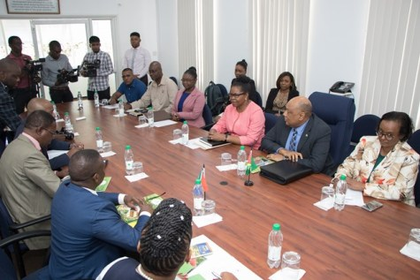 Minister of Natural Resources, Raphael Trotman and his team chat with South Africa's Deputy Minister of Mineral Resources, Godfrey Oliphant and his team during an introductory meeting on Monday.