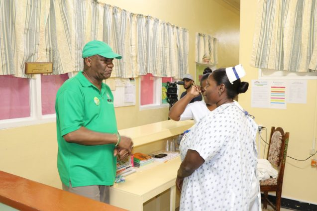 Minister of State, Joseph Harmon interacting with Senior Nurse at the Wismar Hospital, Nurse Joseph