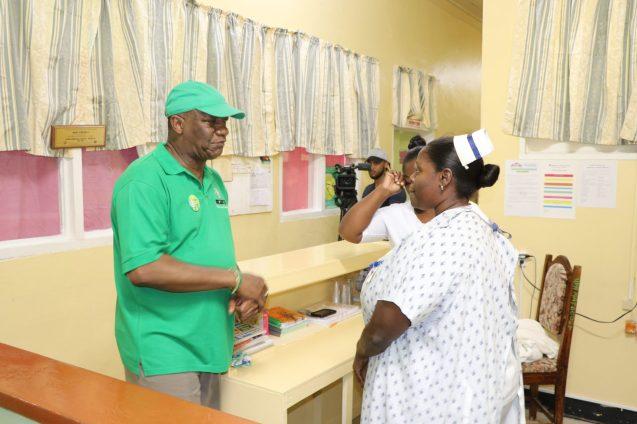 Minister of State, Joseph Harmon interacting with Senior Nurse at the Wismar Hospital, Nurse Joseph