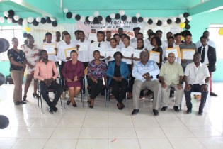 [In the photo, from right to left] Chief Executive Officer (CEO) of the Board of Industrial Training (BIT), Richard Maughn, Deputy Permanent Secretary of the Ministry of Social Protection, Mohan Ramrattan, Chairman of the Board of Industrial Training (BIT), Clinton Williams and officials from the Regional Chairman Office, Region 9, among the graduates.