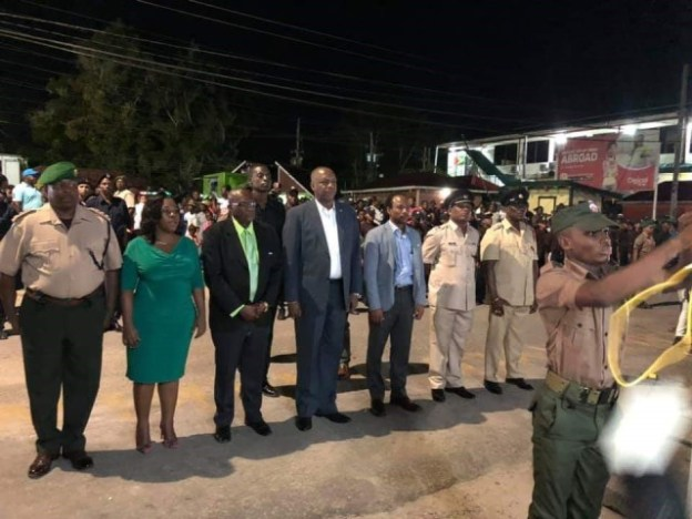 Minister of State Joseph Harmon along with Regional officials and members of the Joint Services witness the hoisting of the flag at the Linden Flag Raising Ceremony.