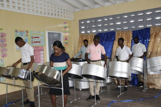 Students and teachers of the Belladrum Secondary School playing a musical rendition after the commissioning exercise