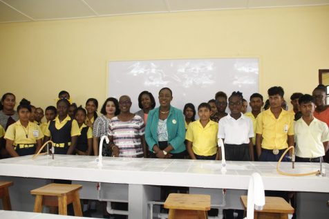 Students of the Woodley Park Secondary School pose with the Education Minister and teachers in their new science laboratory