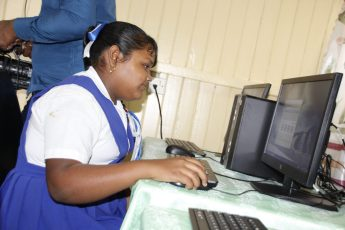 A student of the New Amsterdam Primary School utilising one of the new computers