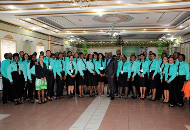 The Cadet Officers taking a photograph with the Chief Education Officer, Mr. Marcel Hutson (centre) and Deputy Chief Education Officer (Administration), Ms. Ingrid Trotman (fourth from left) (Ministry of Education photo)