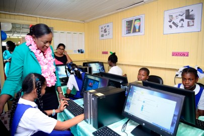 Students in the IT Lab along with Minister of Education, Dr Nicolette Henry.