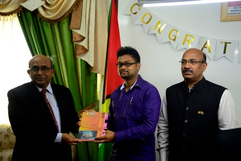 High Commissioner of India to Guyana, H.E. V. Mahalingam present a copy of the ITEC 2017-2018 programme to Mayor of Georgetown, His Worship Ubraj Narine alongside Vijayakumar K, Counsellor, Commerce and Development Cooperation, High Commission of India.
