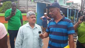 Minister within the Ministry of Finance Jaipaul Sharma listens attentively to a Linden resident