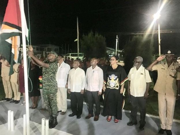 Minister of Foreign Affairs Carl Greenidge along with Regional officials watch with pride as the Golden Arrowhead is being hoisted.