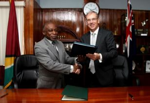 Minister Greenidge and High Commissioner Ojala shortly after signing the Air Services Agreement.