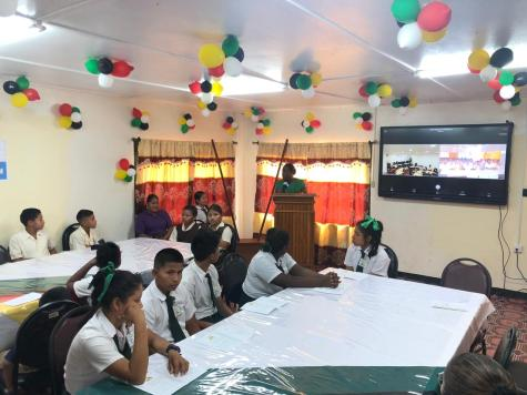 Minister of Education, Dr. Nicolette Henry addressing the students of the Arapaima Primary and St. Ignatius Secondary schools
