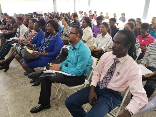 [In the photo, front row] Education Officers of Regions 2 and 3 listening to the Teaching Service Commissioners along with Guyana Teachers' Union Representative Julian Cambridge (seated extreme right - front row).
