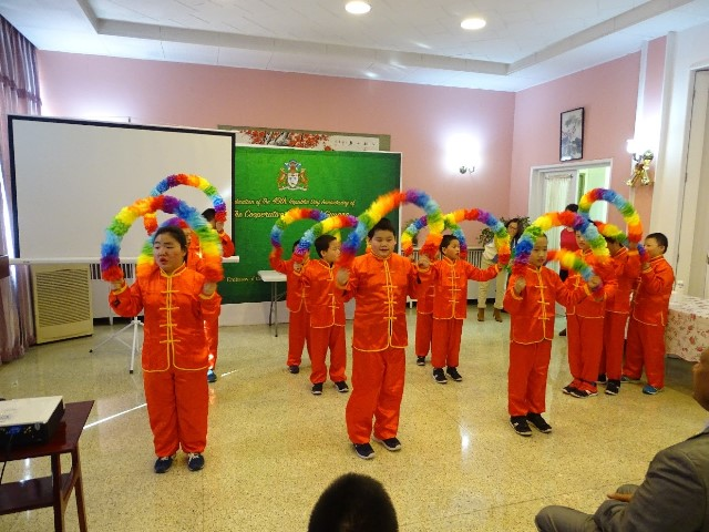 A group of Chinese Orphan kids from the Beijing Welfare Centre with a Cultural display.