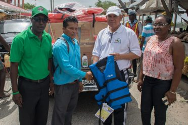 Minister of Social Cohesion, Dr. George Norton hands over new life jackets