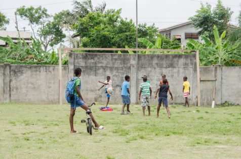 Youth catching up on some football in the Mocha Primary School compound