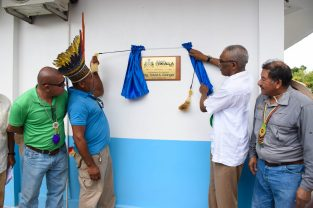 President David Granger [second from left] and Toshao David Henry [second from right] unveiling the plaque of Radio Orealla 95.1FM, as Minister of Indigenous Peoples' Affairs, Sydney Allicock and Minister of Social Cohesion, Dr. George Norton looks on