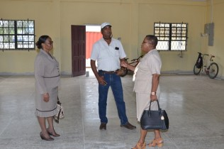 Deputy Permanent Secretary, Lorene Baird and Director of the Childcare and Protection Agency interacts with a contractor.