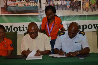 Deputy Vice-Chancellor, Academic Engagement, University of Guyana, Professor Michael Scott, and Director-General (ag) of the Civil Defence Commission, Lieutenant Colonel Kester Craig sign the agreement