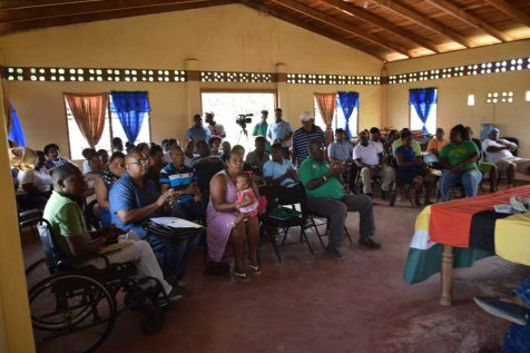 Ituni residents listening attentively to Minister of Natural Resources, Raphael Trotman and a delegation, inclusive of Members of Parliament, Jermaine Figueira and Audwin Rutherford, during a visit to Kwakwani, Region 10 on Saturday