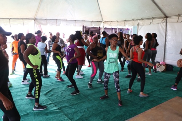 A group of women participating in the Zumba exercise.