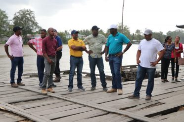 Minister of Public Infrastructure, David Patterson and technical officers inspecting areas of the wharf
