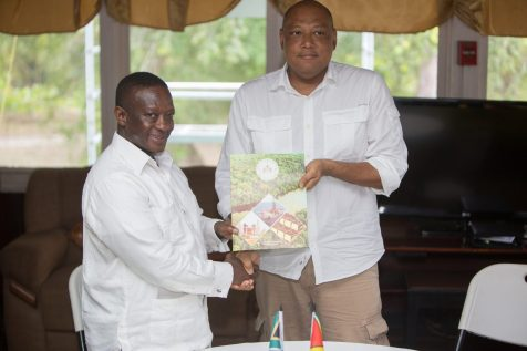 "Minister of Natural Resources, Raphael Trotman and South Africa's Deputy Minister of Mineral Resources, Godfrey Oliphant after the signing of the ""Declaration of Intent"""