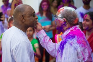 Minister of Foreign Affairs, Carl Greenidge, who is currently performing the functions of president, and H.E. Ventakachalam Mahalingam, High Commissioner of India to Guyana, greet each other with gulal/abrak (coloured powder) during Holi/Phagwah celebrations at the Swami Vivekananda Cultural Centre in Bel Air.