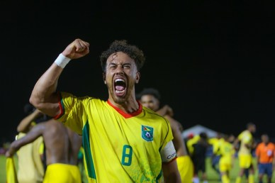 Golden Jaguars Captain Samuel Cox roaring after a historic win against Belize.