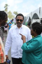 Attorney General and Minister of Legal Affairs, Basil Williams S.C interacting with two citizens.