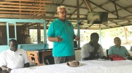 Meeting at Aberdoon, Pomeroon - On the Minister's left is Mr. Sheldon English, chairman of the Moruca-Phoenix Park NDC and on the right is Mr. Michael Bradley, resident of the community.