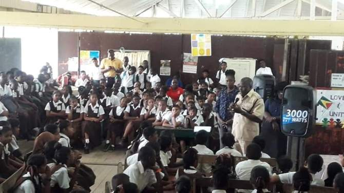 Police Officer Inspector Craig speaking with school children on the usage of the road