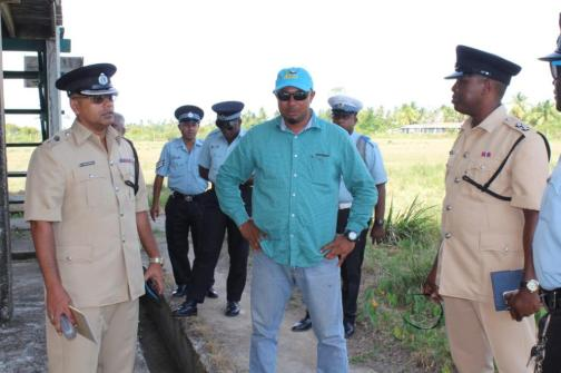 Divisional Commander, Senior Superintendent Khalil Pareshram [left] listening to resident Sattrohan Mahraj [centre] as Inspector Isaacs [right] listens